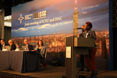 GYA Co-Chair Tolu Oni speaks at joing ICSU / ISSC meeting. Photo by Pichi Chuang