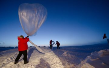 Launching an ozonesonde balloon. Photo by U.S. National Oceanic and Atmospheric Administration on Unsplash